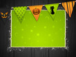 halloween background with bunting on wood