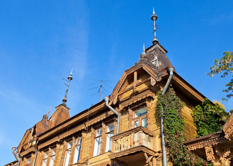 Old wooden house over blue sky in Samara, Russia