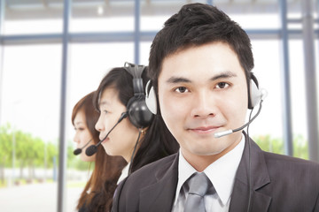 smart asian businessman with call center agent