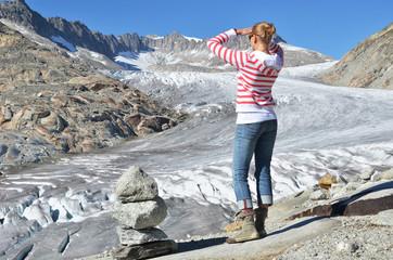 Traveler against Rhone glacier. Switzerland