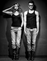 Sexy man and woman dressed casual posing  - retro mood