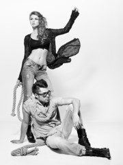 Sexy man and woman dressed casual posing in the studio
