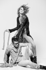 Sexy couple dressed casual posing in the studio - retro mood