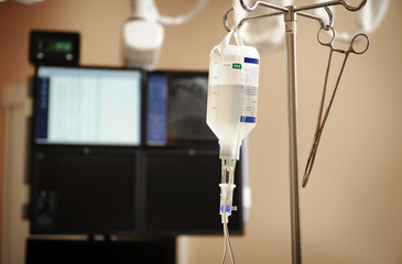 Intravenous drip system on a background of medical appliances