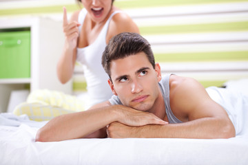 Couple in bedroom  having conflict