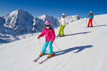 Skiing, winter, ski lesson - skiers on mountainside