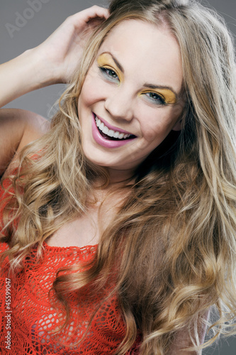 Blonde girl with long curly hair.