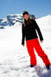 Winter holidays - portrait of young snowboarder girl