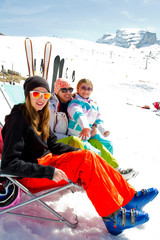 Ski, snow, sun and winter fun - skiers in Dolomites