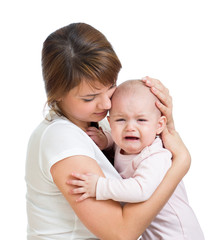 Mother calming her crying baby isolated