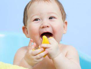 portrait of happy baby taking a bath