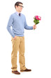 Full length portrait of a young man holding flowers