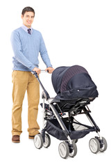Young male pushing a baby stroller