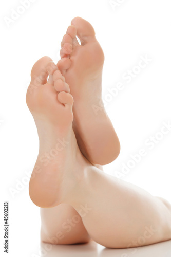 Woman feet over white