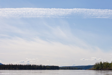 Summer cloud sky over Yukon River near Dawson City