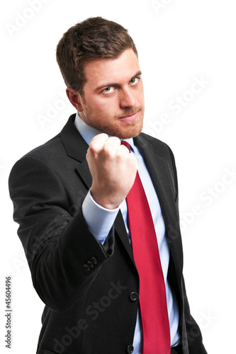 Angry businessman holding his fist