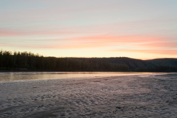 Sunset twilight over taiga at Yukon River, Canada