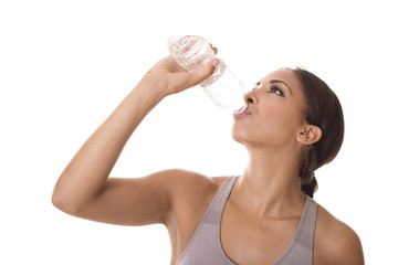 Athlete quenches her thirst with water.