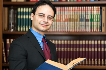 Businessman holding a book in his office
