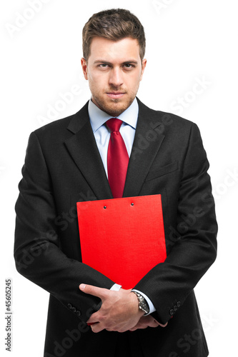 Confident businessman holding some documents