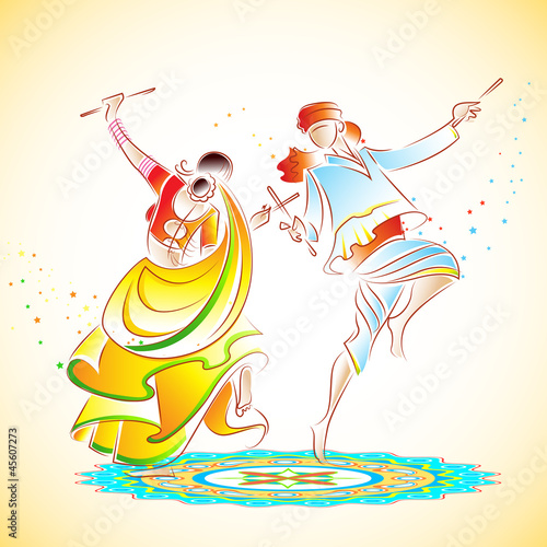 Couple playing Dandiya