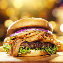 gourmet bacon hamburger with golden background