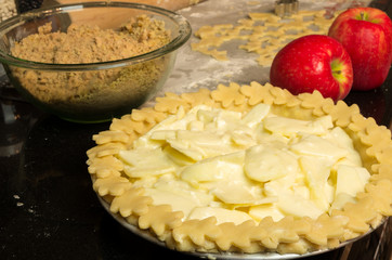Apple pie ready for the oven with apples