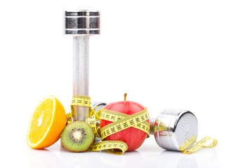 fitness equipment and fruits isolated on white