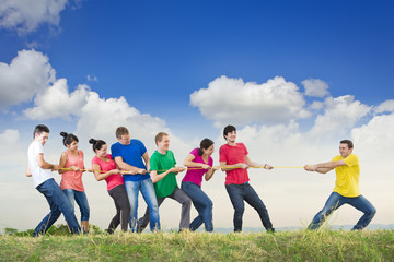 Group of young people pulling a rope