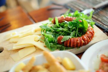 Appetizer arugula and sausage