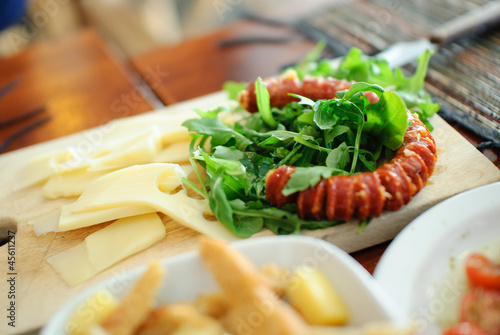 Appetizer arugula and sausage
