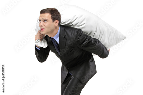 A businessman carrying a money bag