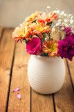 Beautiful flower bouquet on wooden tabletop poster