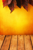 Background with autumn leaves and wooden tabletop poster