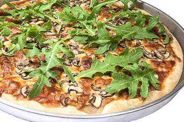 Traditional Italian Pizza with arugula, mushrooms and cheese.