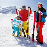 Fototapety Skiing, winter fun - happy family ski team