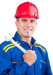 Portrait of young mechanic with hard hat in overalls and wrench