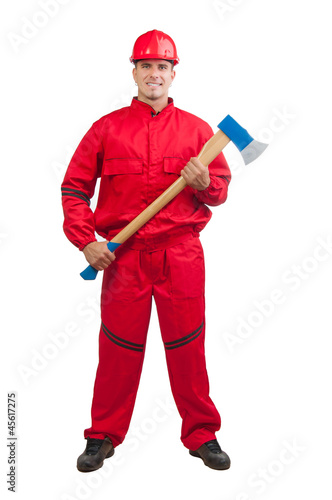 Young smiling fireman with hard hat, uniform holding huge ax