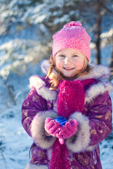 girl with christmas toy outdoor