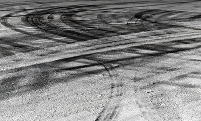 Abstract road background with crossing of tires tracks
