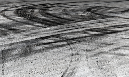 Foto op Plexiglas Motorsport Abstract road background with crossing of tires tracks