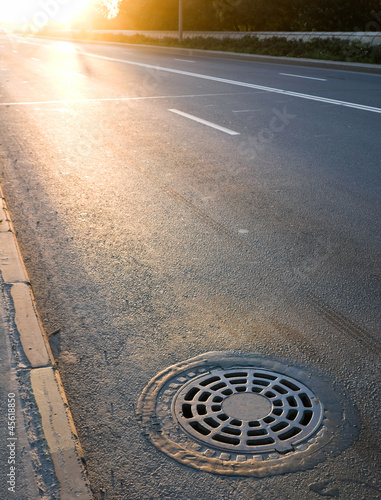 Sewer manhole cover on the roadside