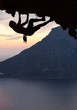 Silhouette of a rock climber at sunset. Kalymnos Island, Greece.