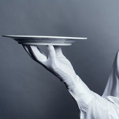 a large plate on the arm waiter