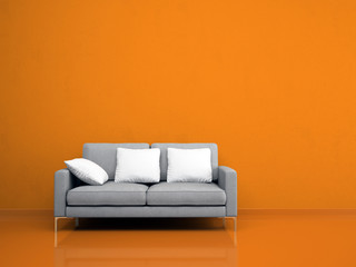 Modern grey sofa on the orange wall