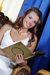 young beautiful woman reading menu in restaurant