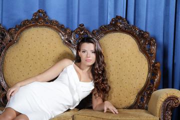 young beautiful elegant woman relaxing on sofa