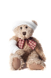 teddy bear with bandaged head and arm, isolated