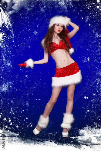 Winter portrait of beautiful sexy girl wearing santa claus cloth