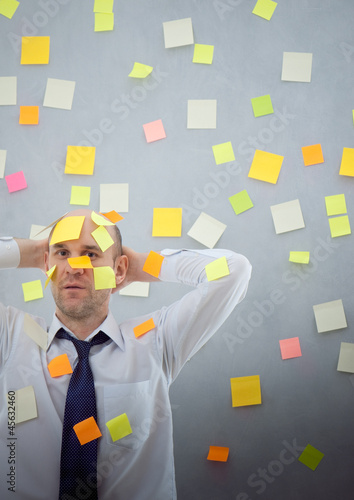 businessman with many notes